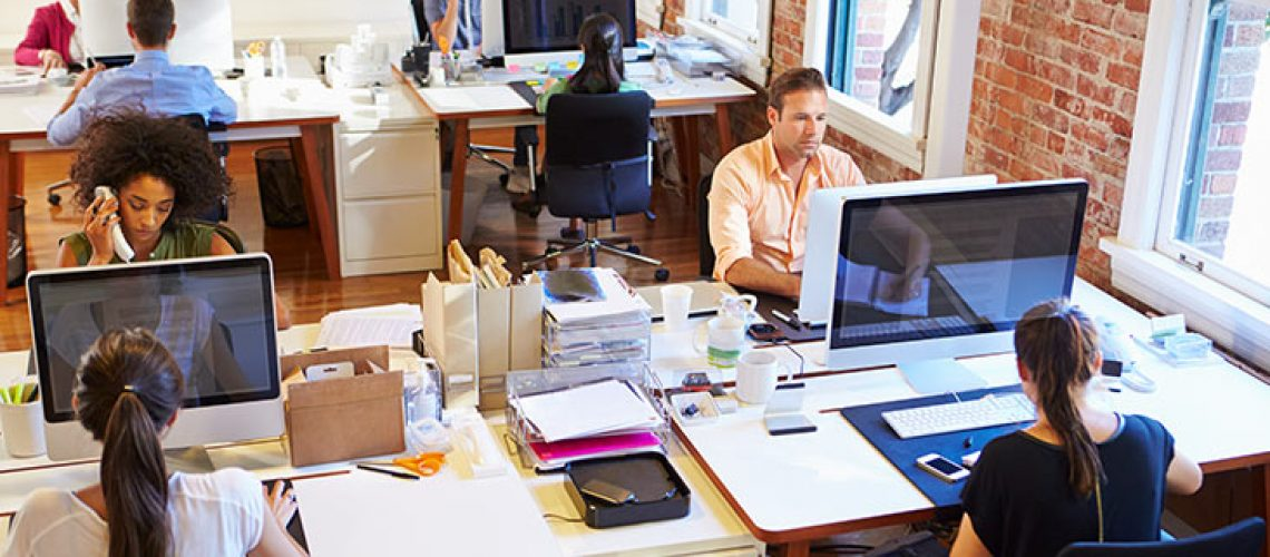 Group of people working at their desk